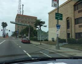 nº 5 pour Photoshop a public city sign that goes over the street par paulpetrovua