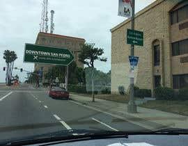 nº 6 pour Photoshop a public city sign that goes over the street par paulpetrovua