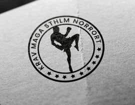 Nro 33 kilpailuun I need a logo for my Krav Maga club to print t-shirts, bags, webpage and so on käyttäjältä owaisahmedoa