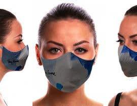 Nro 19 kilpailuun Create two product photos of a facemask using the design attached käyttäjältä raransikasrimal4