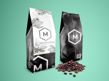 For this contest, the client wanted a coffee label with a vintage/modern design to it. The logo of the company was attached but it was indicated that we can use just an M in a hexagon for it.  The following text were also required to be included:   Made in South Africa 250g Freshly roasted specialty coffee 100% Arabica coffee beans MOORS Gift Shop