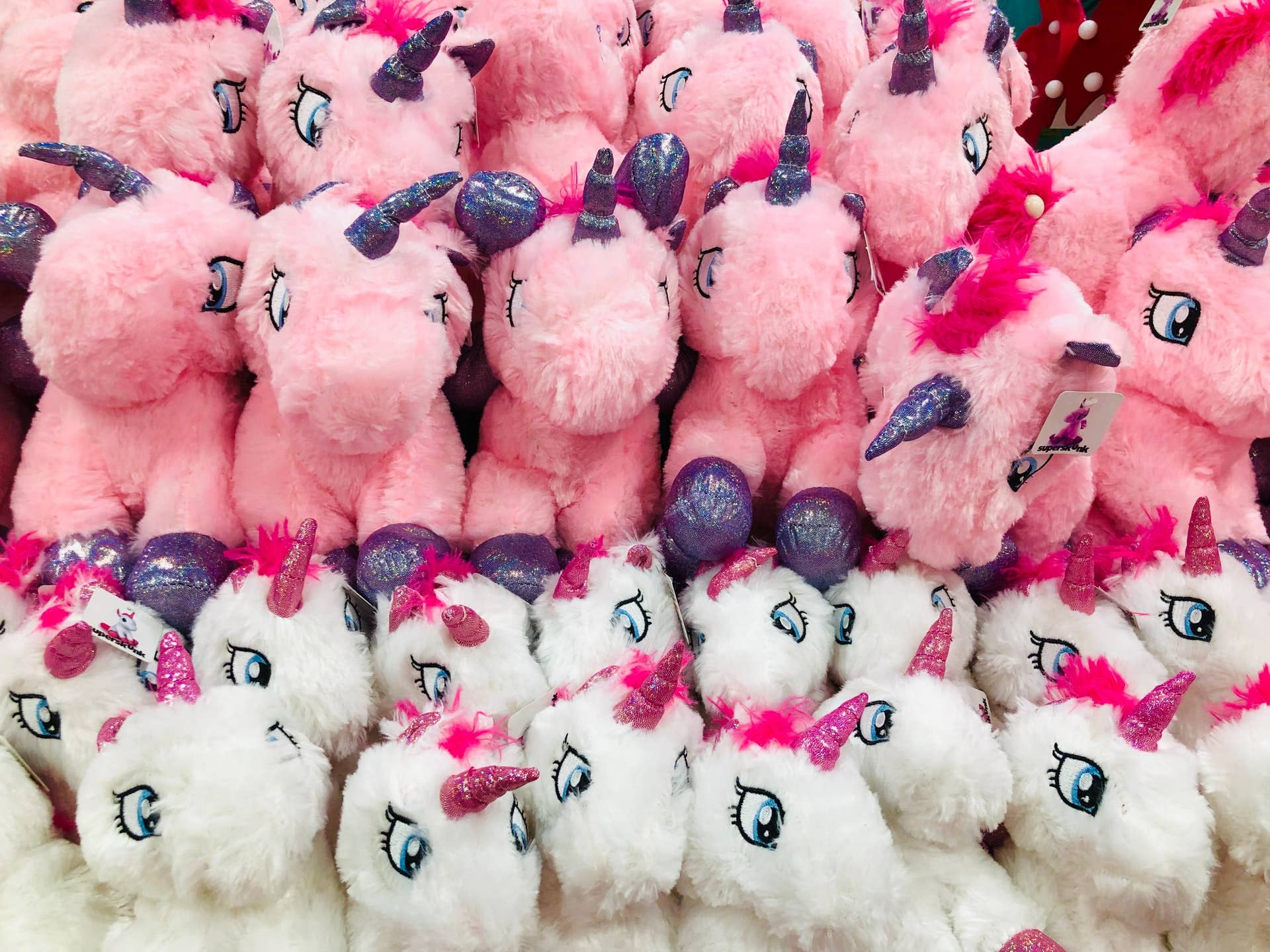 collection of plush unicorn toys